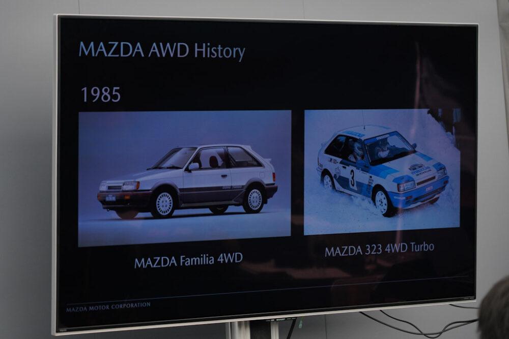 マツダ SUV オフロード試乗会プレゼンスライド。マツダAWDヒストリー。1985年、ファミリア4WD、323ターボ。